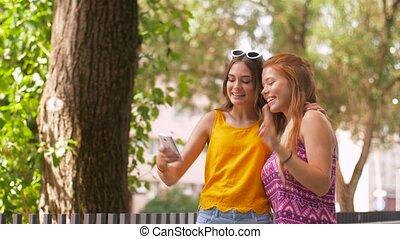 teen girls taking selfie by smartphone in summer -...