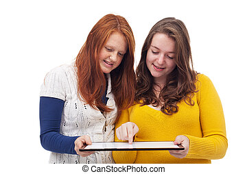 Teen girls with tablet computer