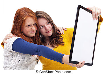 Teen girls with tablet
