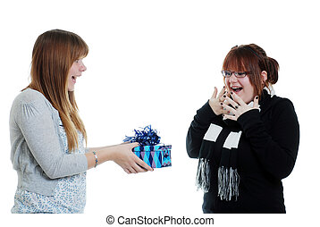teen giving her sister a present