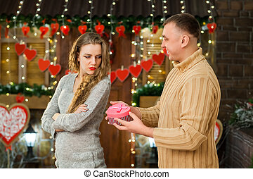 teen giving present to his young girl