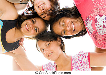 teen group  - a group of teens with their head together