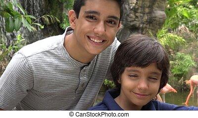Teen Hispanic Boys Smiling at Zoo