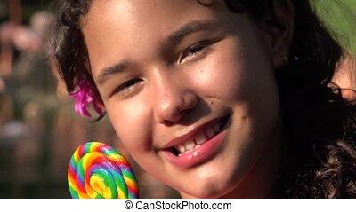 Teen Hispanic Girl Eating Lollipop