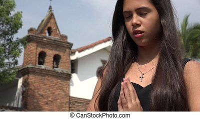 Teen Hispanic Girl Praying at Church