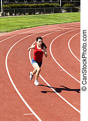 Teen Hispanic Woman Running On Track Shorts And Top