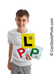 Teen holding magnetic driving license plates for car - A...