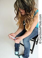 Teen holding pregnancy test