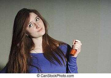 Teen holding Prescription Bottle - Teen holding prescription...