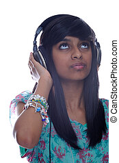 Teen Indian Girl Listens To Music
