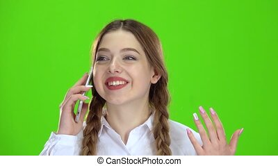 Teen is talking on the phone . Green screen - Teen is...