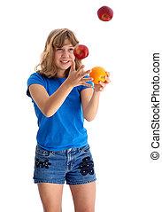Teen Juggling Apple and Orange 2 - Adolescent girl juggling...