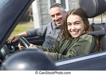 Teen learning to drive or taking driving test.
