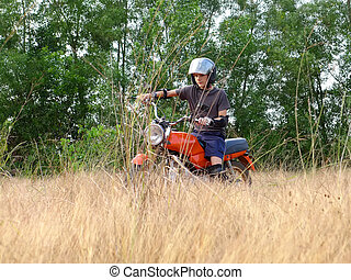 Teen learning to ride on motorcycle 2