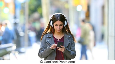 Teen listening to music dancing in the street