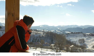 Teen looking at beautiful landscape at the mountains in winter time