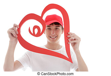 Teen looking through a red love heart