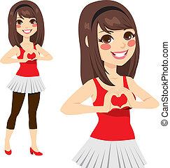 Teen Love Heart Sign - Brunette teen girl making love sign...