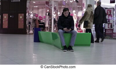 Teen lying on a bench with your phone