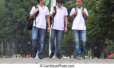 Teen Male Students Walking