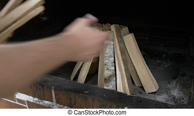 Teen man preparing the wood sticks into barbecue grill