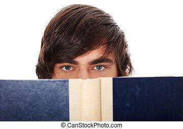 Teen man reading book