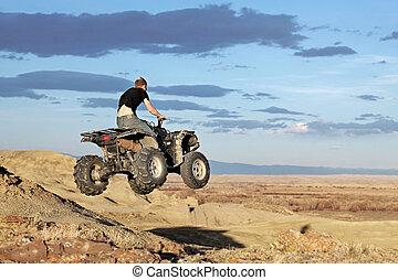 teen jumping on a quad - four wheeler 4x4 gets some air