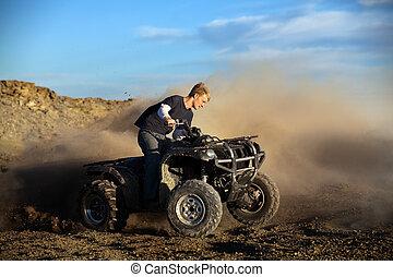 teen on quad four wheeler - Teen male riding quad /...