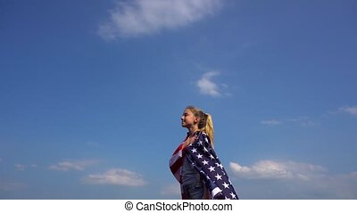 Teen patriot with USA flag in nature - Side view of young...