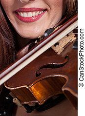 Teen playing violin
