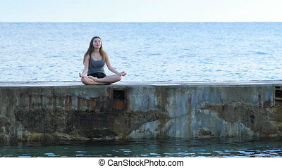 Teen practicing yoga on the beach - Happy teen practicing...