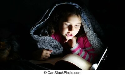 teen reading girl child reads book at night with flashlight...