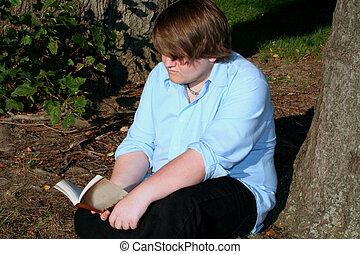 Teen Reading Outdoors
