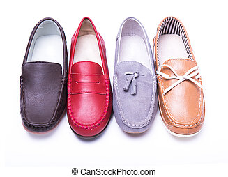 Teen red moccasins on a white background