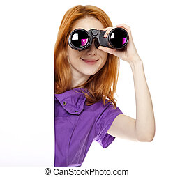 Teen redhead girl with binoculars isolated on white...