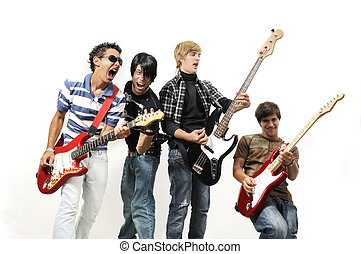Teen rock band - Portrait of young musical band playing with...