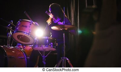 Teen rock music - gothic girl percussion drummer performing with drums, slow-motion