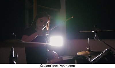 Teen rock music - Passionate dashing girl percussion drummer...