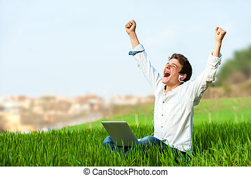 Teen shouting of joy outdoors. - Happy teen with laptop in ...
