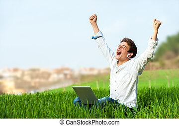 Teen shouting of joy outdoors. - Happy teen with laptop in...