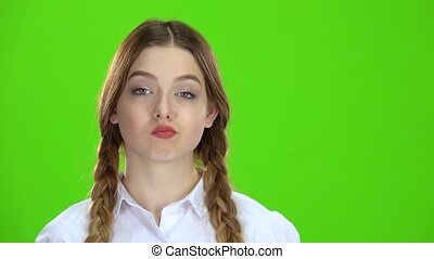 Teen shows a ok smiling at her white blouse. Green Screen