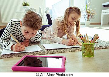 Teen schoolchildren studying at home during coronavirus quarantine