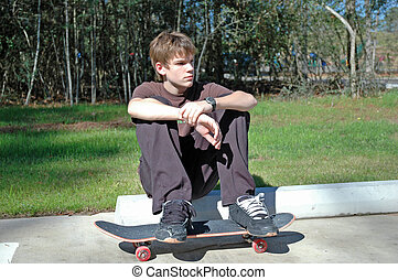 Teen Skateboarder - A portrait of a teen skateboarder at...