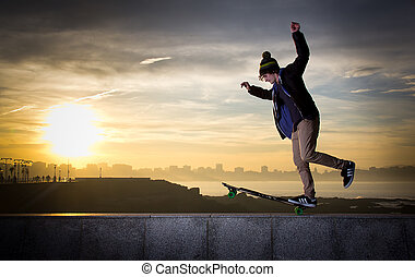 teen skateboarder - young teenager with a longboard