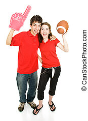 Teen Sports Fans - Teen couple roots for their football...