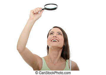 Teen student girl with magnifier