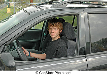 Teen SUV Driver - A teenaged boy drives his parent\\\'s...