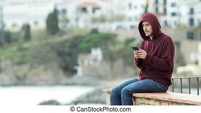 Teen texting on phone and looking away