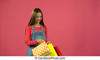 Teen with bags in their hands and rejoices at their...