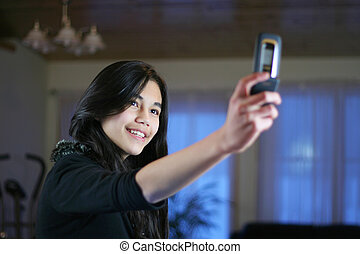 Teen with camera phone